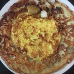 Delicious savory eggs and sausage Dutch pancake