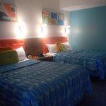 2 queen bed room, partial wall with door to living area.