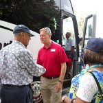Victor greeting Fulton Walker as the family boarded the buses