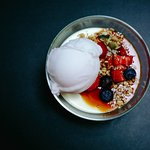 Handmade panna cotta topped with sorbet.