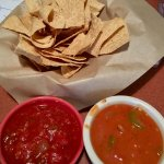 Fresh Chips and Salsa. Salsa on rt mild. Salsa on left hot. Delicious!