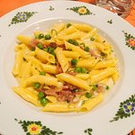 Lovely penne pasta with peas and prosciutto