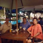Enjoying long cool cocktails on terrace by pool