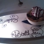 Surprised us with a birthday dessert including a candle to blow out