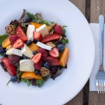 Aragula, brie, wallnuts, fruits and all sorts of colored tomatoes.. this is our summer salad!
