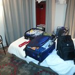 Not much room for luggage. Only one-way traffic around bed. Small closet.