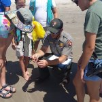 Park Ranger on a beach walk. Learn something while your enjoying the sun.