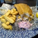fish, chips and pink coleslaw, all served on fake newspaper!