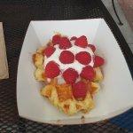 Waffle with creme fraiche and fresh raspberries!