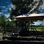 Gazebo & double swing on our guest's deck with an octagon picnic table!
