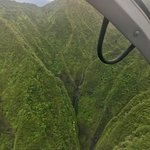 One of my favorite photos, doors off helicopter tour with Nathan over the Sacred Falls location