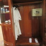 closet with bathrobes, slippers and safe