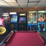 Arcade with pool table, video games, Pinball machines and prize games.
