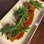 BOCCONCINI FRITTI Deep fried mozzarella cheese in breadcrumbs spicy tomato sauce and rocket sala