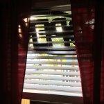 neon sign theadbare curtains