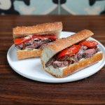 FILET MIGNON: caramelized onion, roasted tomatoes, black pepper mayonnaise on a baguette