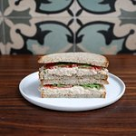 TUNA SALAD:albacore tuna, romaine lettuce, tomatoes, watercress on whole wheat sourdough bread