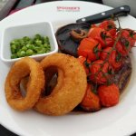 Rump Steak, mushrooms, onion rings and vine tomatoes with chips on the side