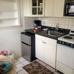 Small kitchen with table for two. Small fridge; no dishwasher, but who needs more?