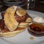 Pancakes w/bananas, bacon, maple, and cream
