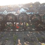 Lobster pots stacked on the harbour ready for use by Johnshaven fishermen