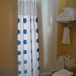 Nice size tub/shower combo with counterspace