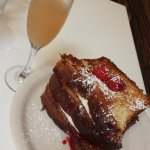 Raspberry and brie stuffed french toast and a mimosa