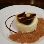 Mediterra cheesecake with fresh sliced figs, graham cracker crumbs, and chocolate drizzle..YUMMM