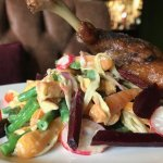 """Cuisse de canard"" slow cooked duck leg with root vegetable salad"
