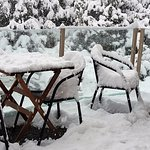 Snow on balcony furniture