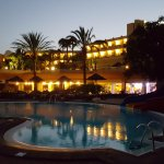 Evening shot, looking at main pool and hotel lit up.