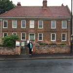 My wife outside the rectory in Epworth, where John and Charles Wesley grew up.