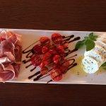 Serrano ham, buffalo mozzarella, tomato & greek basil salad, with balsamic glaze