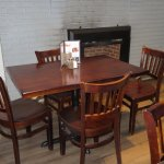 Wood Tables, Unupholstered Chairs, Vinyl Plank Floor, Comfortable, But Noisy
