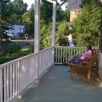 Pre-breakfast coffee on the front porch, with view of the front and side gardens.