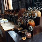 Several types of jam and all kinds of fresh made breads for breakfast