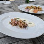 Two cold starters - fish eggs with creme fraiche and onion, and smoked salmon on potato rostis.