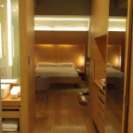Our room when you open the door. Very modern & chic. Be careful of the bed frames, shin bashers