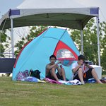 A large grassy area leading to the water is perfect for a blanket, or umbrella.a beach