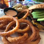 The onion rings, with a side of bacon avocado burger