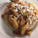 Warm apple pancakes topped with slivered almonds & dusted with powdered sugar