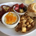 The Sampler....yum! Grits, bacon and egg, fresh fruit, biscuit, fried potatoes...big portions!