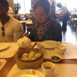 Ester serving tea....soup and dumplings