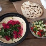 Delicious Beet Hummus, pita, and israeli salad.