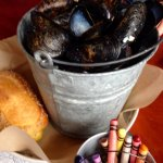 Half-gallon mussels appetizer with melted butter and bread