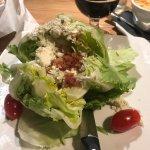 Wedge salad. Appears more head of lettuce salad.