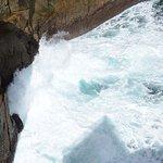 The crashing waves down below
