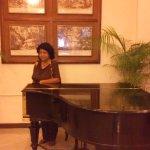 At reception near the antique piano
