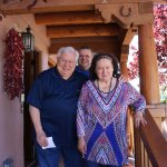 3 happy guests on the front porch of Casa Cuma after a delicious breakfast.