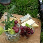 Selection of British & continental cheeses, biscuits, celery, grapes & house chutney board and p